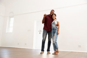 Portrait of Couple Moving Into New Home Together